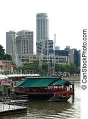 City Scene, Singapore - A river scene, with skyscrapers in...