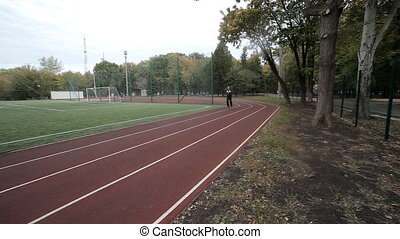 male running on the track at the stadium