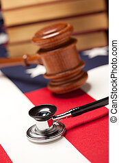 Gavel, Stethoscope and Books on Flag - Gavel, Stethoscope...