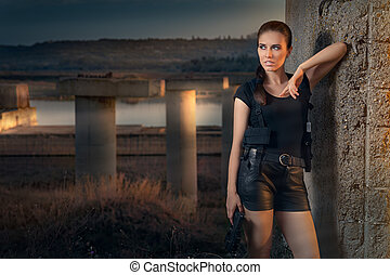 Girl Holding Gun Action Movie Style - Portrait of a girl in...