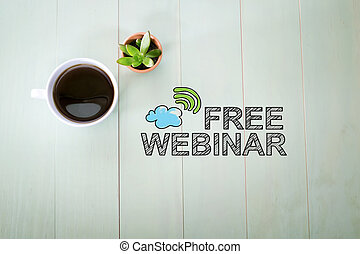 Free Webinar concept with a cup of coffee on a pastel green...