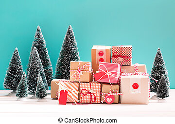Little gift boxes in miniature evergreen forest - Collection...