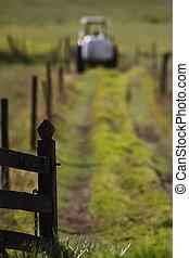 Tractor entering farm