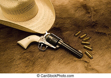 Old Revolver - An old werstern revolver with ammo and a hat...