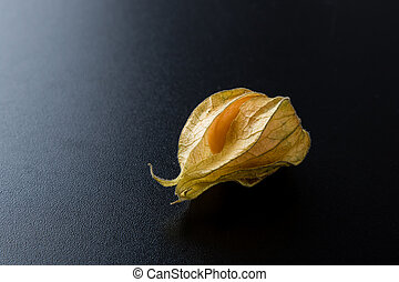 physalis - fresh natural exotic physalis on black table