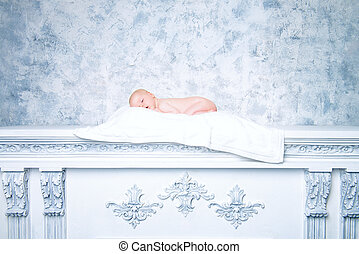 innocence - Beautiful newborn baby sleeping peacefully on a...