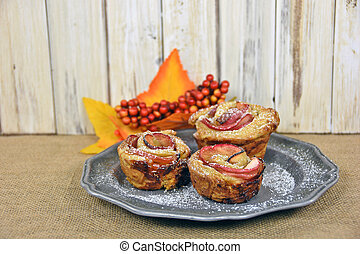apple rose pastry on pewter plate - Baked apple rose pastry...