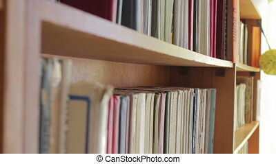 Library shelves with books. - Old and new books are on the...