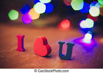 I Love You - I love you text with colorful light on wooden...