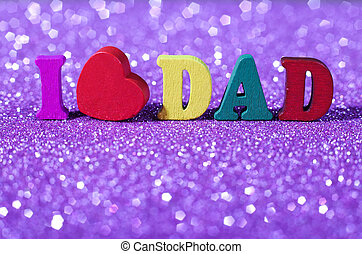 Father Day Concept - Colorful word I love dad standing on...
