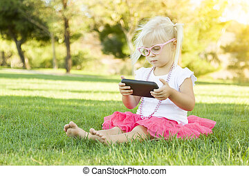 Little Girl In Grass Playing With Cell Phone - Cute Little...