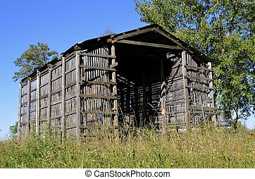 Old air drying wood corn crib - A very old abandoned corn...