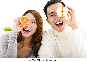 happy Young couple showing healthy food