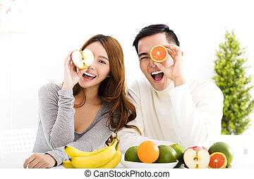 happy Young couple eating fruit and healthy food