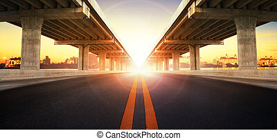 sun rising behind perspective on bridge ram construction and...