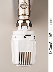 thermostat heating - the thermostat of a radiator is on full...