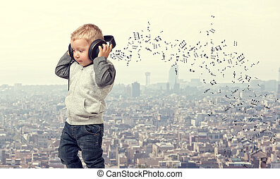 little child with headphone and modern town background