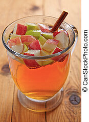 Apple  cider with red and green apples and cinnamon stick