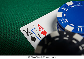 Poker chips on table with cards