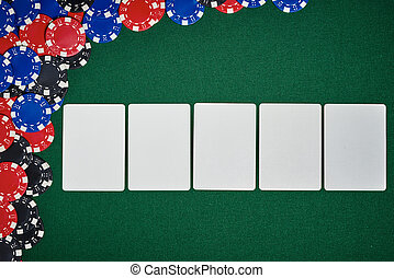 Poker chips on table with blank cards