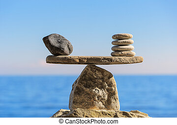 Exactness - Symbol of scales is made of pebbles on the...