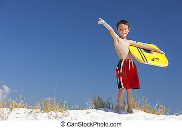 Boy Male Child Pointing on Beach With Surfboard