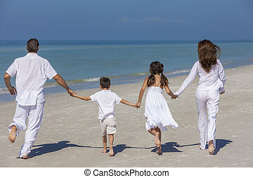 Mother Father and Children Family Running on Beach - Rear...