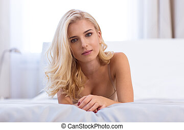 Charming woman lying on the bed