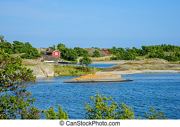 Lonley red huts - Small red huts on an island in the...