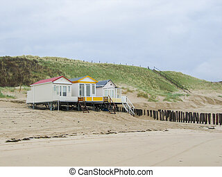 Three lonley cabins - Three small white cabins on an empty...