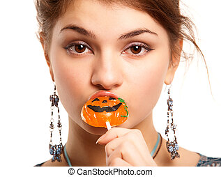 Girl with sugar pumpkin - Portrait of pretty girl sucking...