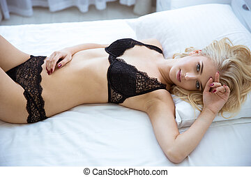 Sexy girl in lingerie lying on the bed - Portrait of a sexy...