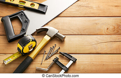 carpentry - variety of carpentry tools on wood planks with...