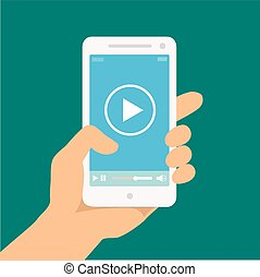 Mobile phone with video player on the screen in a human hand