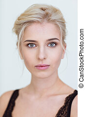 Charming woman looking at camera - Beauty portrait of a...