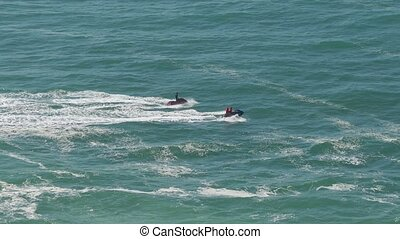 Two Watercraft Floating in Atlantic Ocean, sunny day