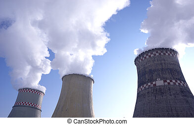smokestacks of thermal power plant with steam on blue sky...