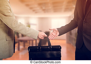 business transfer handover of a suitcase partners - business...
