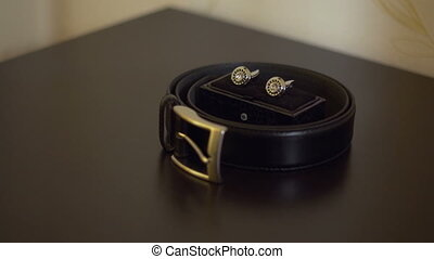 mens Accessories - Mens belt, twisted a ring in the center...