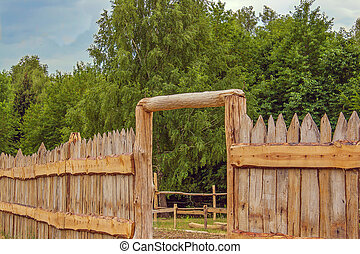 log palisade fence with a gate - Image log palisade fence...