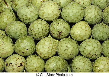 cherimoyas - a pile of cherimoyas in a vegetables market