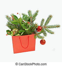 Paper shopping bag with Christmas decorations on white...