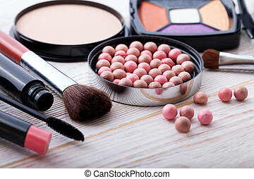 Cosmetics make-up on white wooden. background. Top view mock...