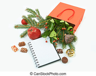 Paper shopping bag with Christmas decorations and notebook...