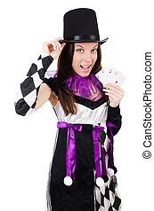 Pretty girl in jester costume with cards isolated on white