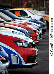 rally cars - Several colorful and aligned rally cars on the...