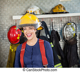 Cheerful Firewoman At Fire Station - Cheerful firewoman...