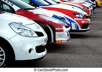 Aligned rally cars - View of some colorful aligned rally...