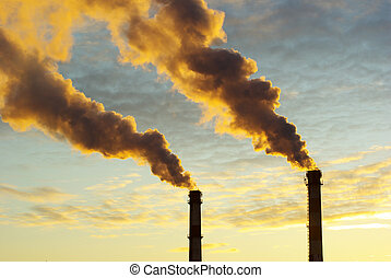 global warming - Power plant with smoke under sunset