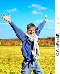 Happy Young Man outdoor - Happy Teenager with Hands Up run...